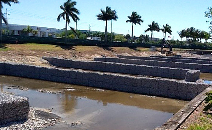 View of crenellations/baffles being constructed in existing pond.